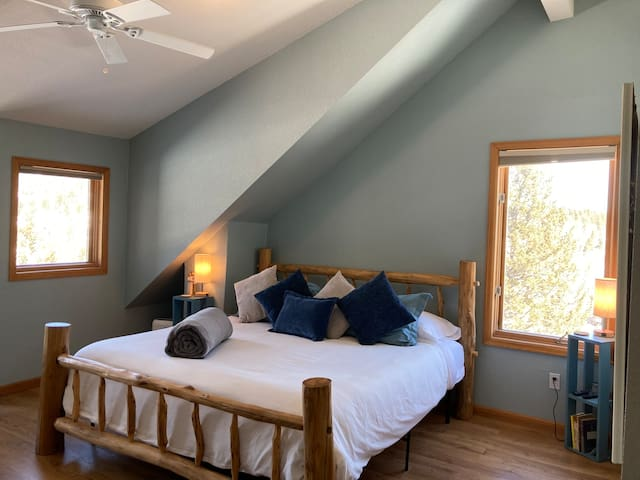 Master bedroom with king bed. Beautiful views of the continental divide mountain range and bald and Sugarloaf Mountain