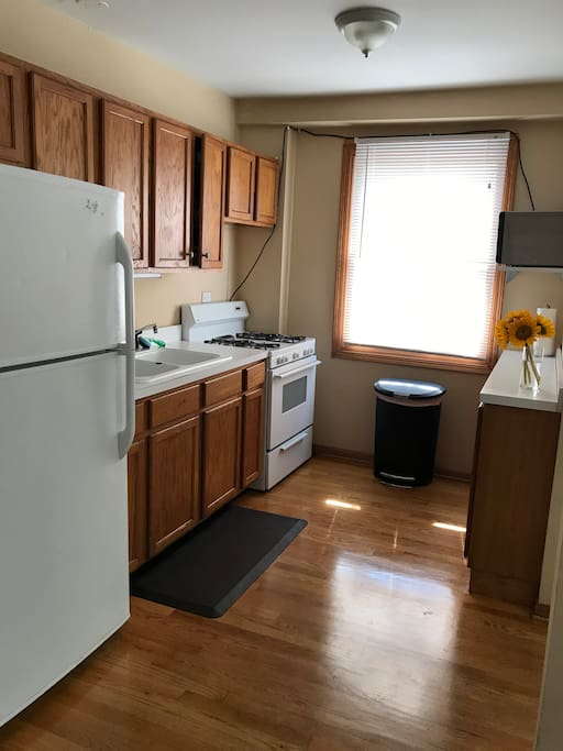 Kitchen with fridge, Keurig, stove, and microwave.