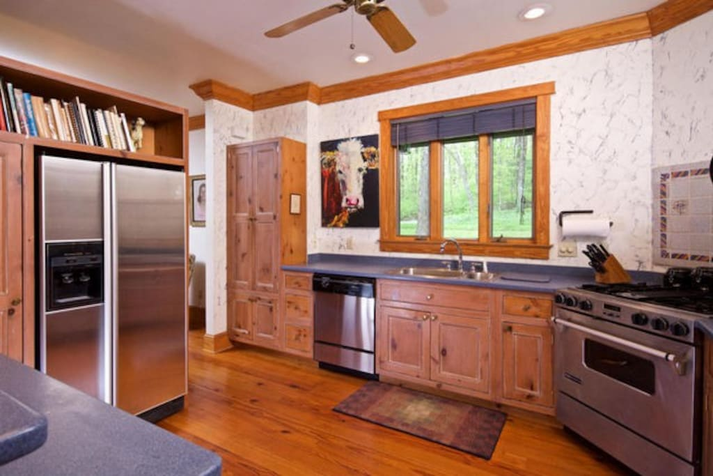 Kitchen open to living and dining area. Top-of-the line appliances.