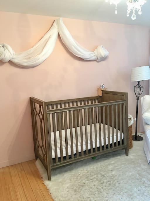 Kids room with 2nd crib and air mattress for adults if needed.