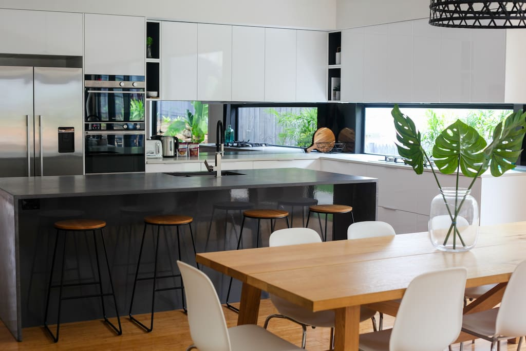Huge kitchen with Fisher & Paykl appliances and concrete benchtops