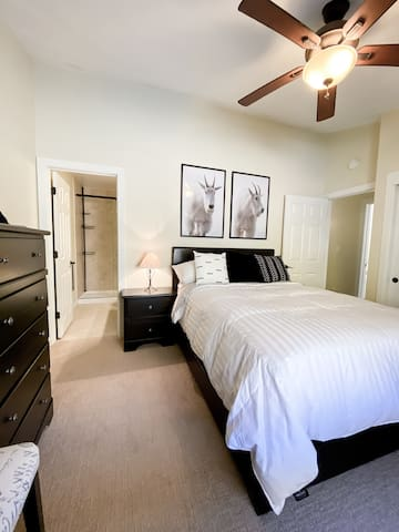 A second bedroom with a queen bed and private bathroom.