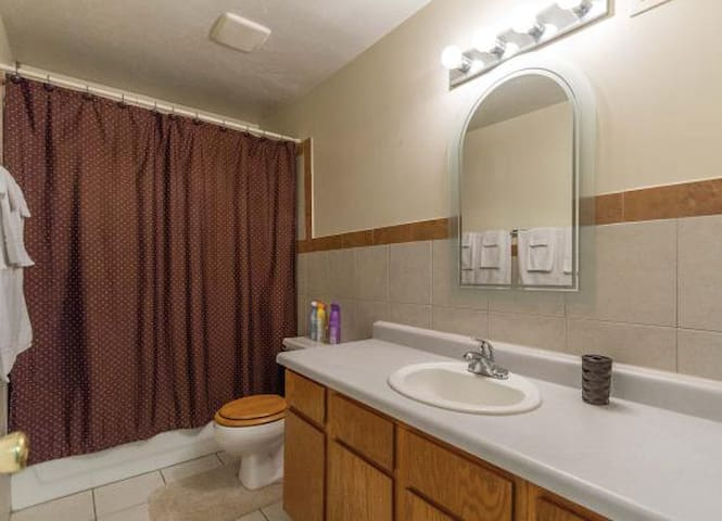 A full size bathroom - lots of countertop space - a full tub and shower.