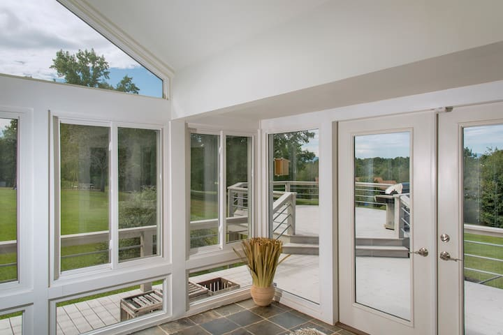 Nice sunroom that opens into the main living room with views of the mountains.