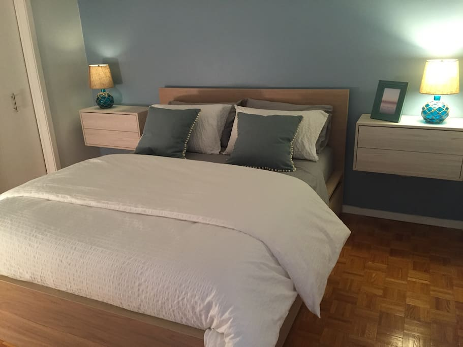 Queen bed with floating side tables
