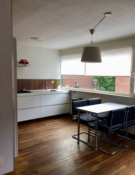 living room is connected to the kitchen