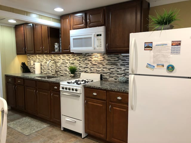 Beautiful, bright updated kitchen with lots of cabinet and counter space. Full size microwave, fridge with icemaker and gas stove