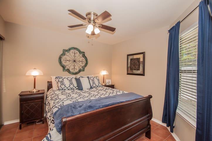 Comfortable queen bed.  Mounted TV in room.