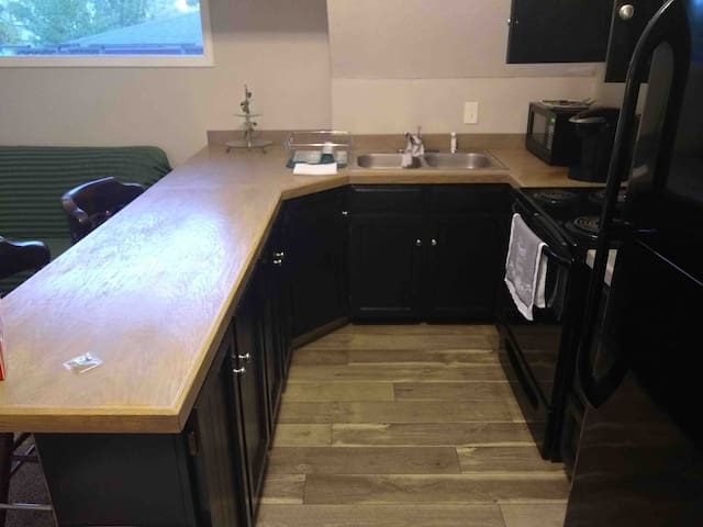 """Brand new renovated kitchen with """"Butcher Block Wood Counters, New luxury wood plank floor and Mikasa China Dishes! """""""
