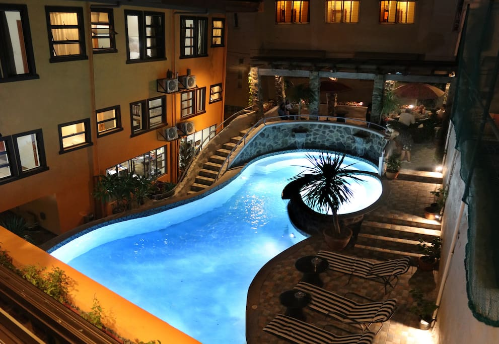 View of the Pool at night time (From the Dining Room)