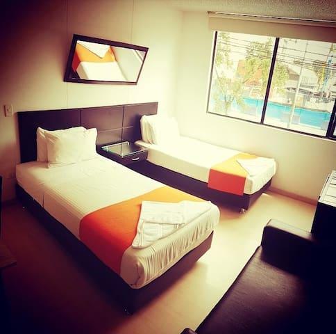 Aparta suite Doble - Hotel Business Ferial