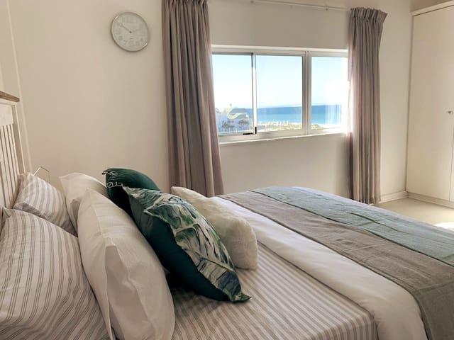 Watch the dolphins from the upstairs bedroom