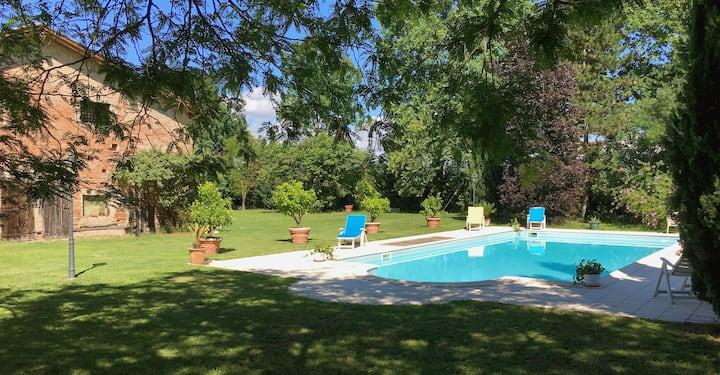 Ca'ssoletta 56, camera vista giardino e piscina