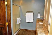 Bathroom--Enjoy a toasty plush towel, fresh off the towel warmer.
