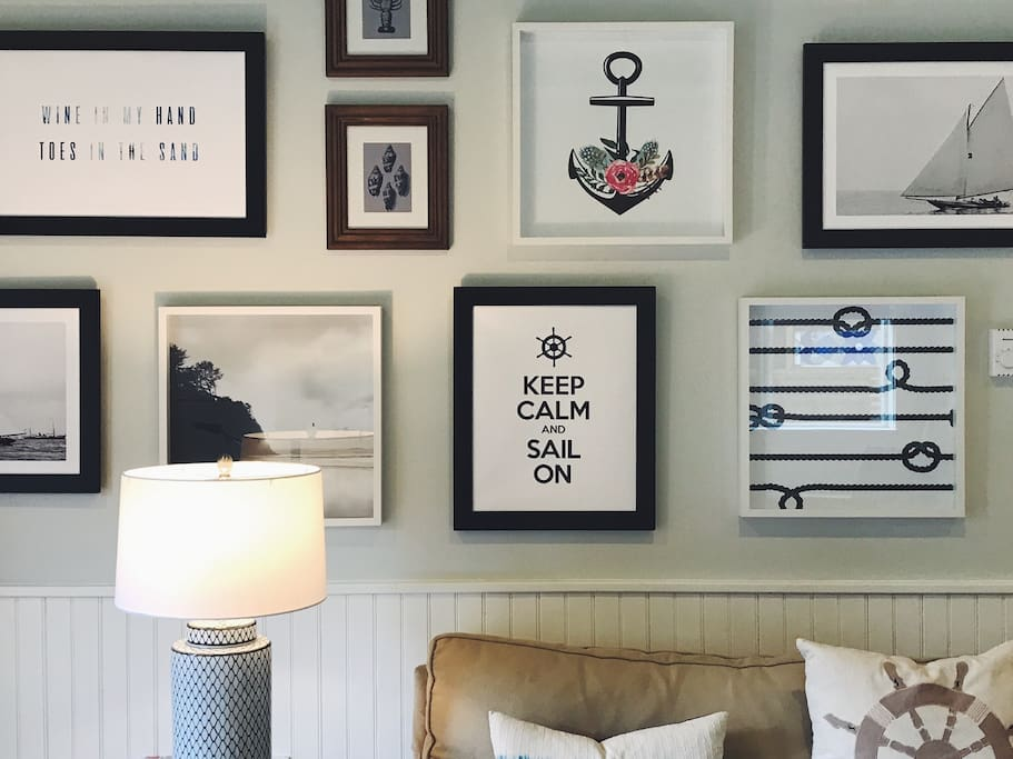 A detail of the nautical-inspired wall gallery.