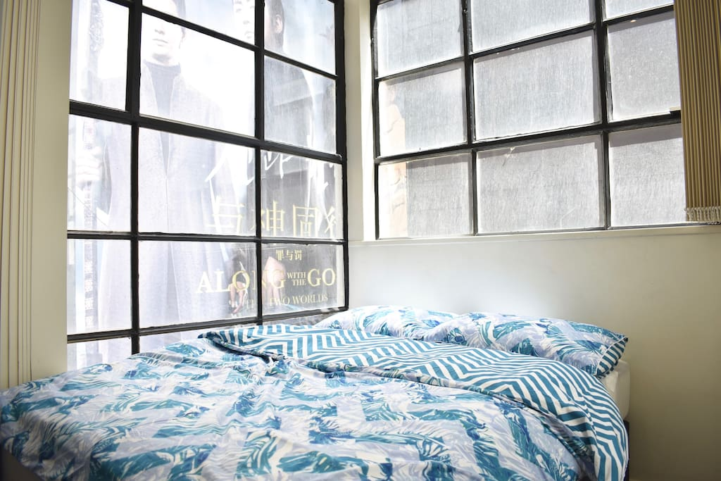 Double room with large warehouse windows