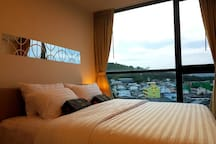 A nice view from the bedroom you can look out to see all over the area of Samkong district while sleeping in the day or night. Premium pocket spring mattress for your sleeping quality, you can sleep all day without boring. (TV also in the bedroom)