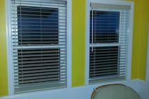 Newly installed blinds in master bedroom