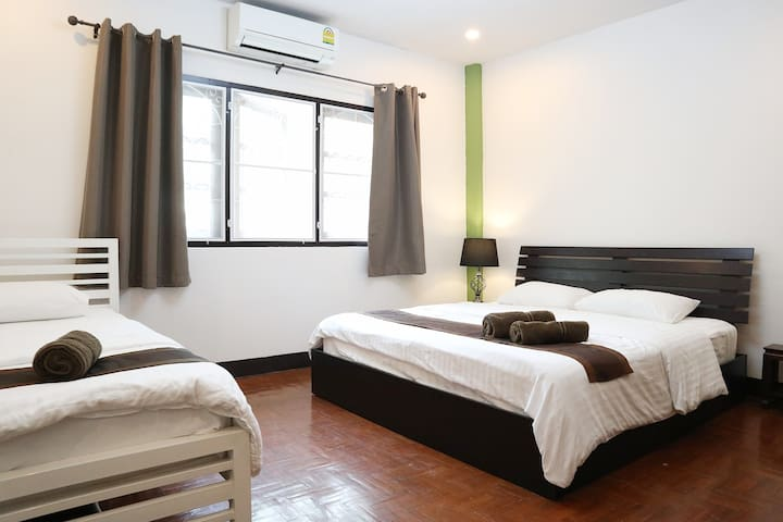 Rear bedroom. All bedrooms have air conditioners. (Downstairs are fans only, but it keeps fairly cool there.) There is one king size double bed and also one single bed here.