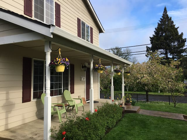 Our beautiful house has a green lawn, a front porch and side patio, a garage and driveway, and is located in the heart of downtown McMinnville.