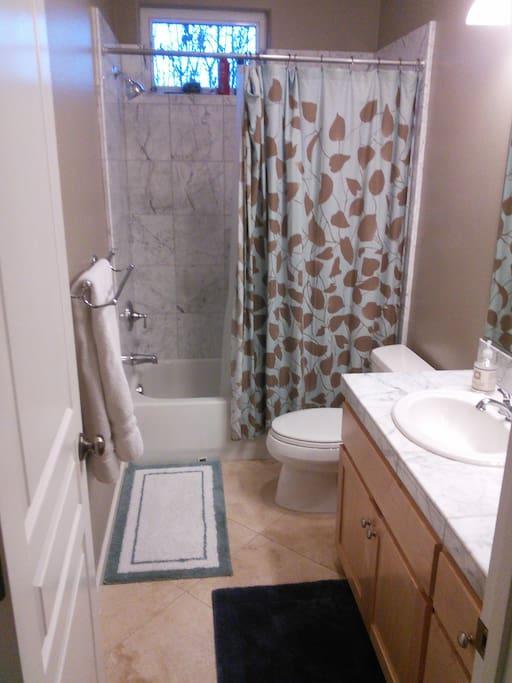 Full bath with amenities