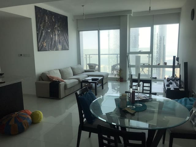 Room in a 56th Floor smart home with amazing views