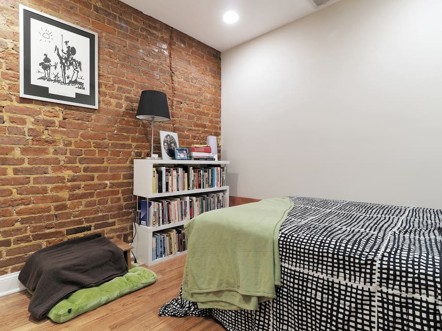 Here is your cozy guestroom with exposed bricks for a restful night's sleep.