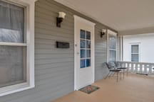 Front porch. You can sit on the front porch or enjoy your coffee on the back porch as well.