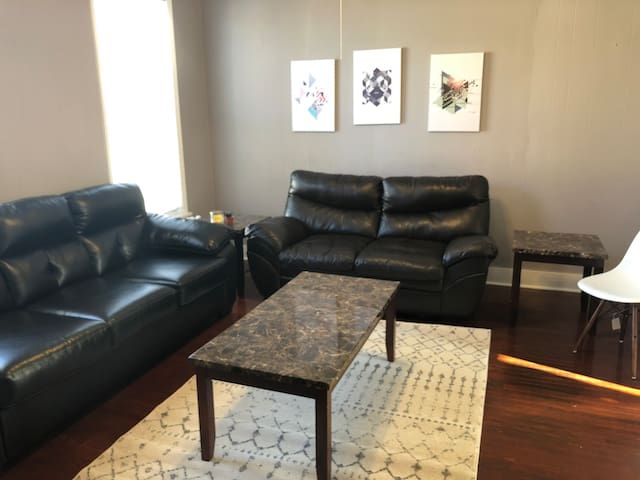 The shared living area has two sofas and a TV!