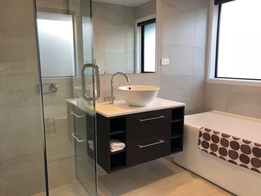 Your own bathroom and separate toilet with hand basin. Bathroom has a shower and bath, heated floors and heated towel rail, heater and fan.