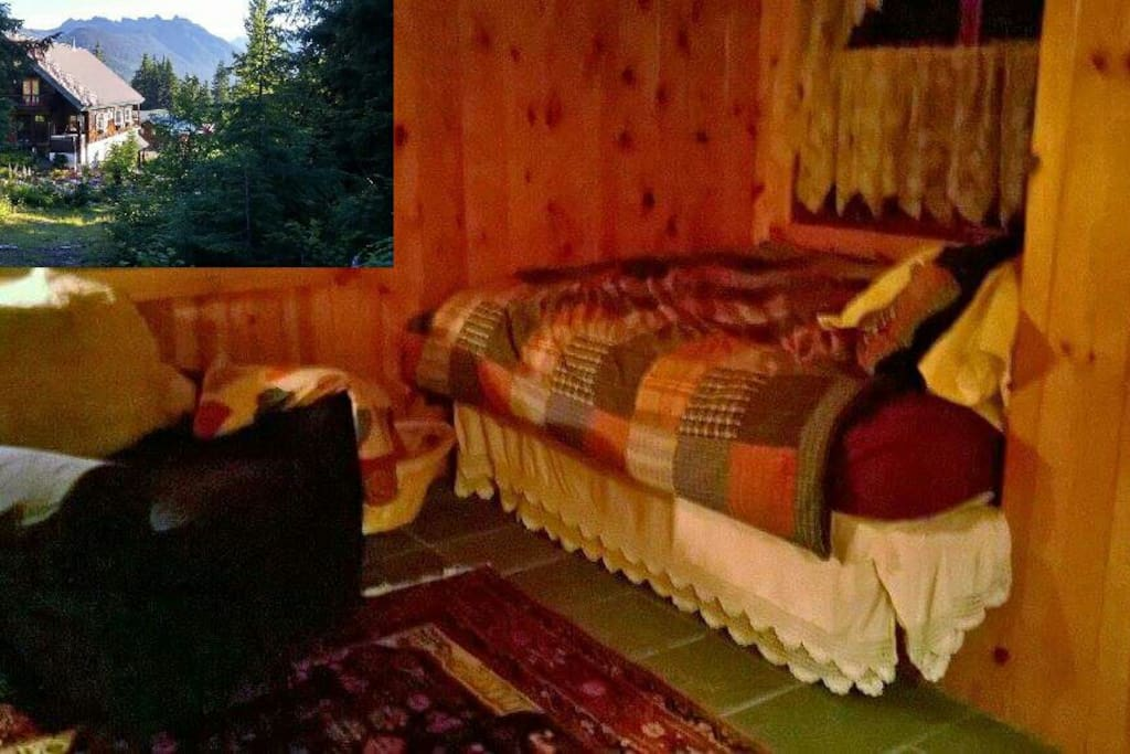 Cozy full sized bed.  Snuggle under a downy quilt and enjoy the view from two windows.