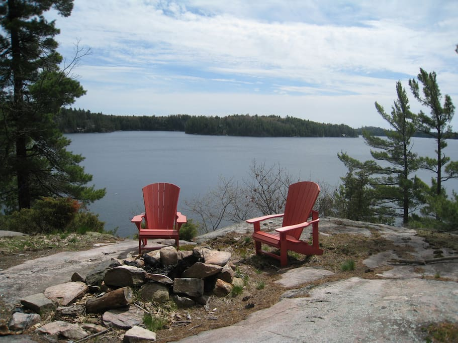 Muskoka chairs by the firepit