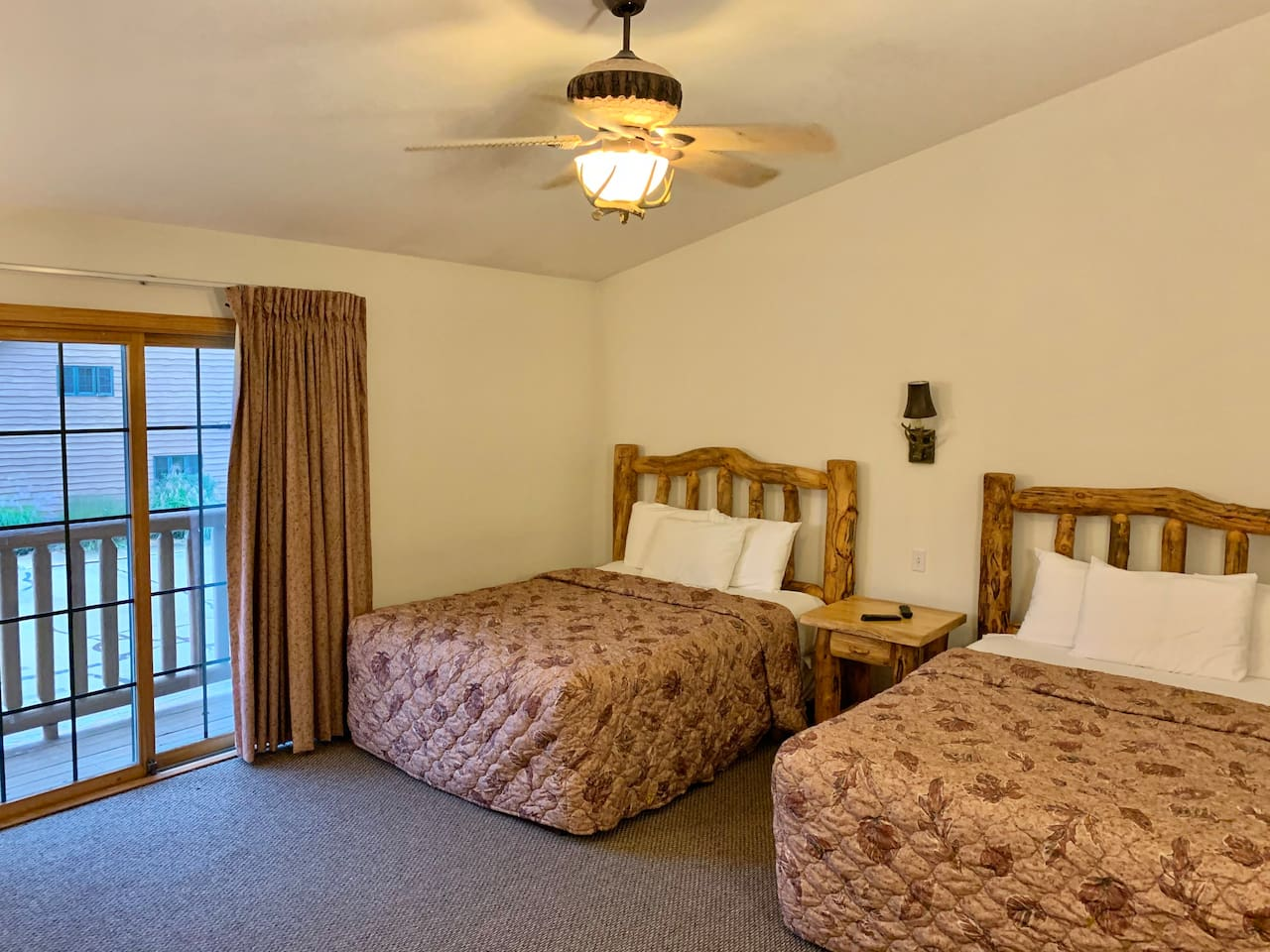 Enjoy the double queen suite with private access to beautiful balcony overlooking the area.