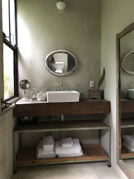 Privet bathroom with two showers one inside and one outside