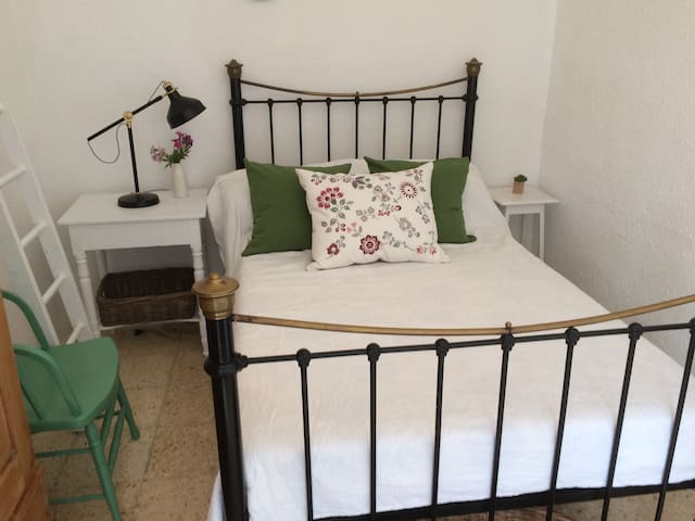 Room interior with double bed