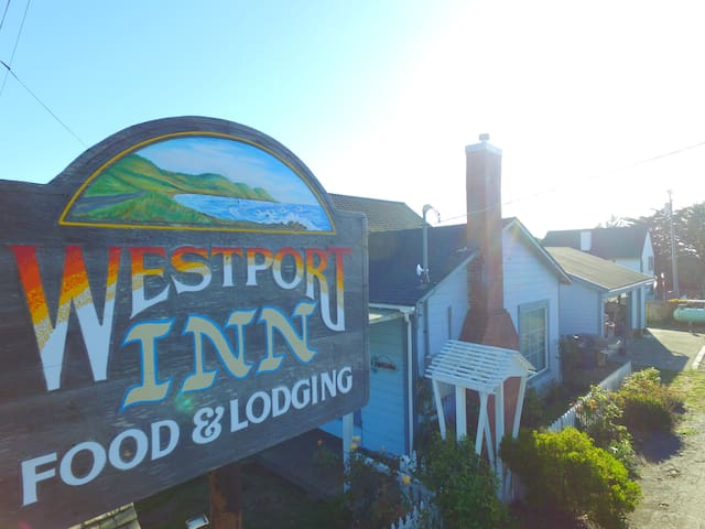 Westport Inn main office/house. Features a dinning table and lounge. Breakfast items are available in the main office.