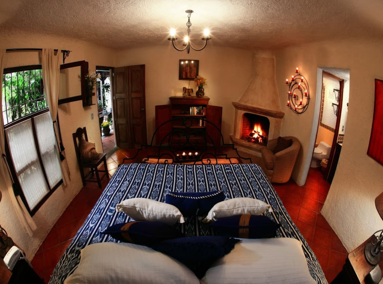 Romantic room with one king bed, fireplace, tv, private bathroom.