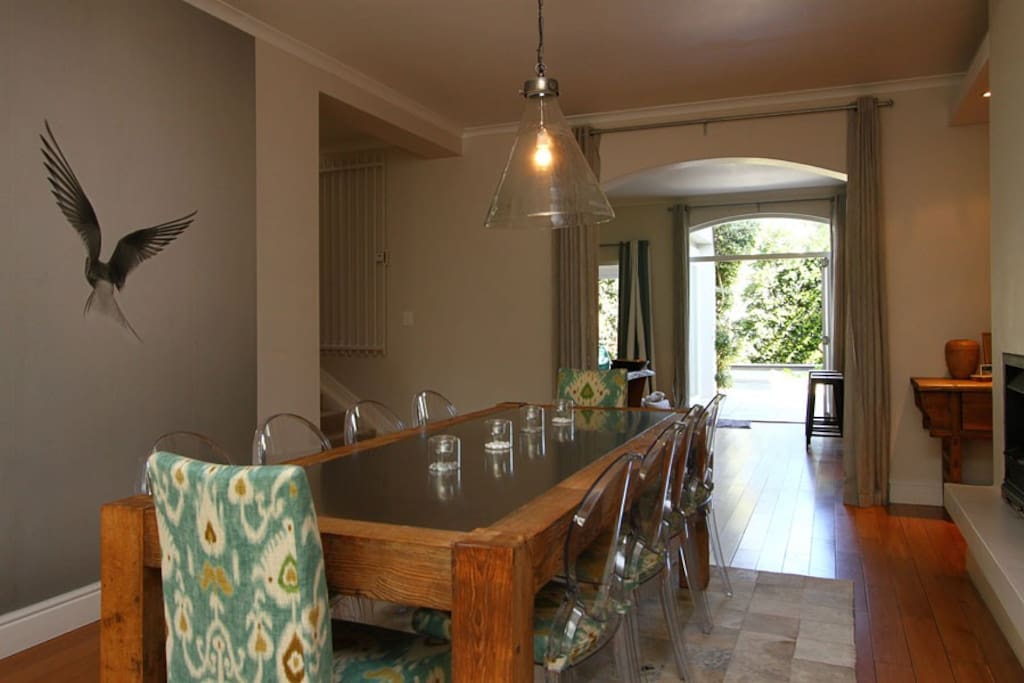 Entrance and dining room leading to private garden