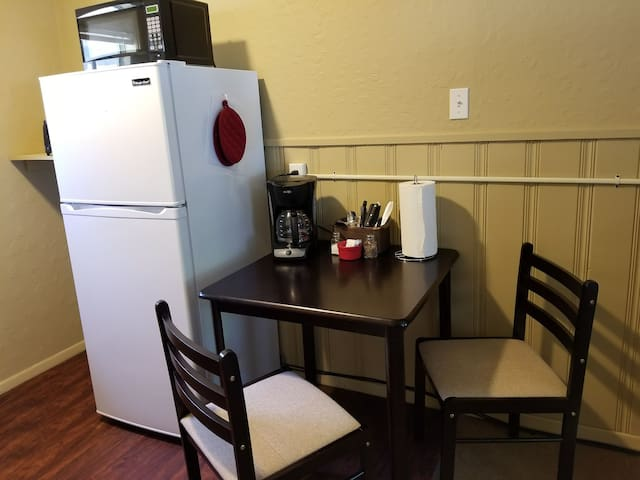 Table and fridge in the Kitchen
