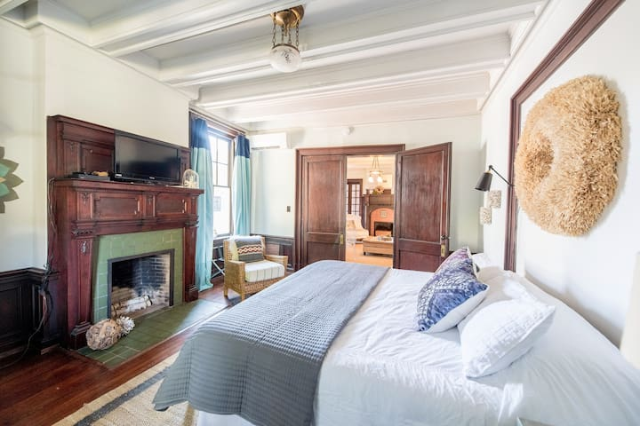 A king-size bed provides a great rest in what was the former cigar parlor.