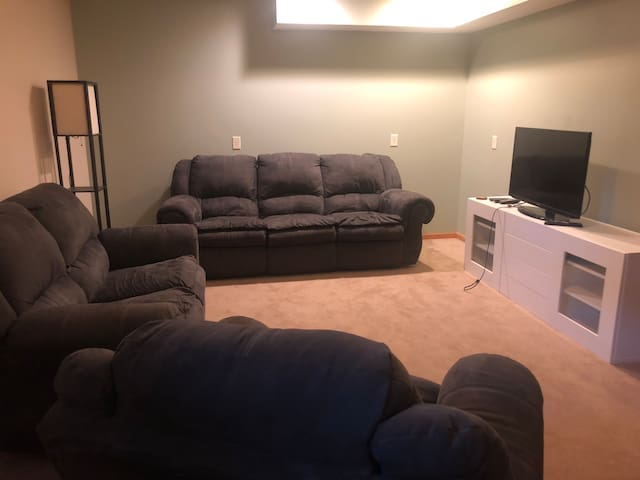 Living room with new comfy furniture, large TV - can stream Netflix and raid our dvd library. Comfy space to relax and hang out. Also an elliptical to use while if you'd like.