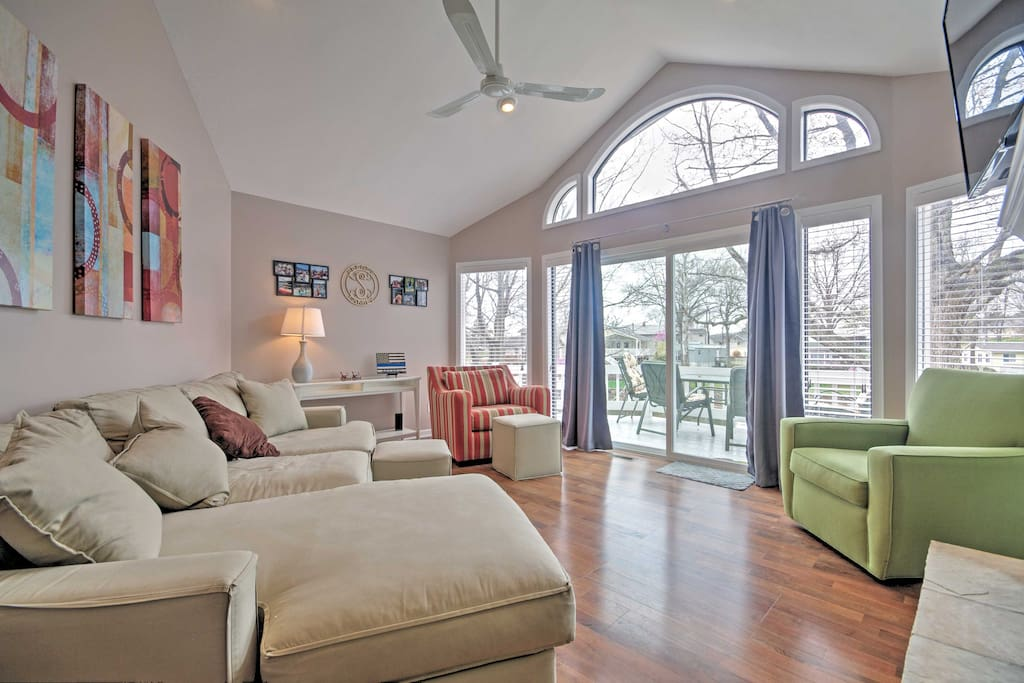Floor to ceiling window treatments allow natural light to flood throughout this home.