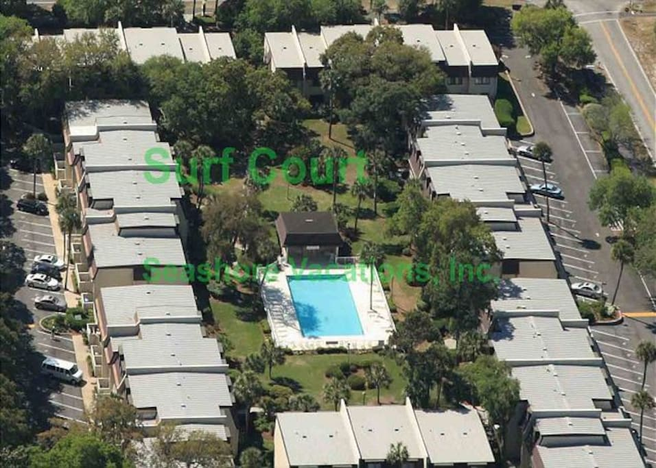 Aerial view of Surf Court, where our quiet condo is next to the pool on the left.