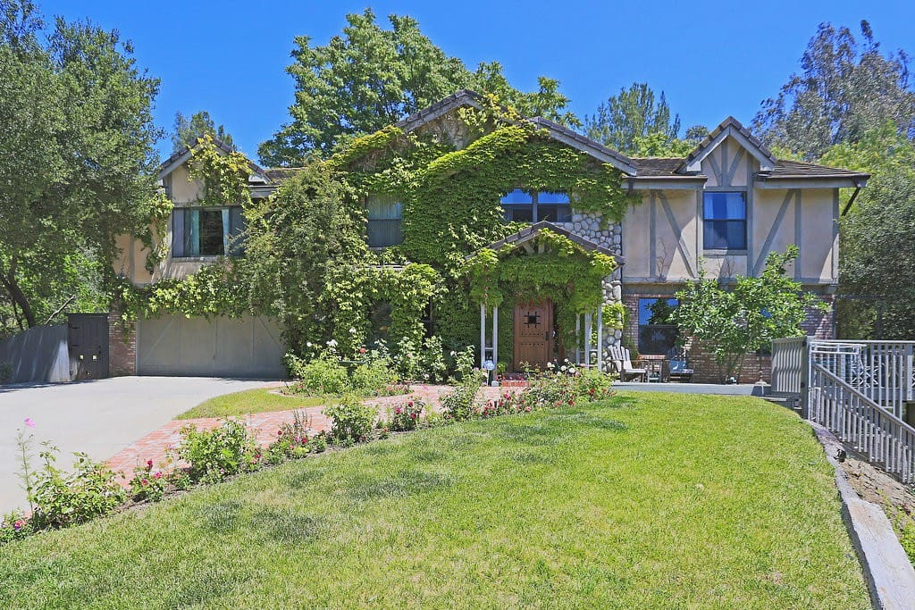 In the heart of Malibu Canyon, in the lovely community of Edenwild sits this lovely country home.