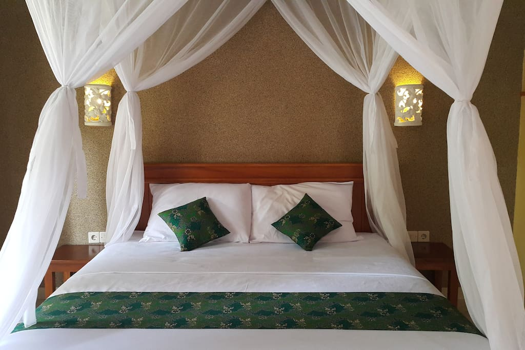 King size bed, stone carved lights, and bed side tables