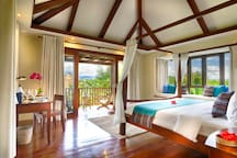 Bedroom 3: Vaulted ceilings, canopy king-size bed, bay window and sea views with balcony
