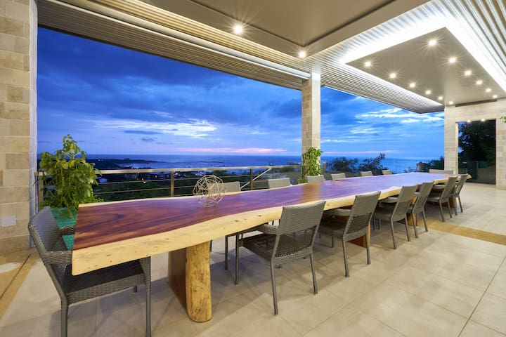 Massive dining table to have dinner with a view