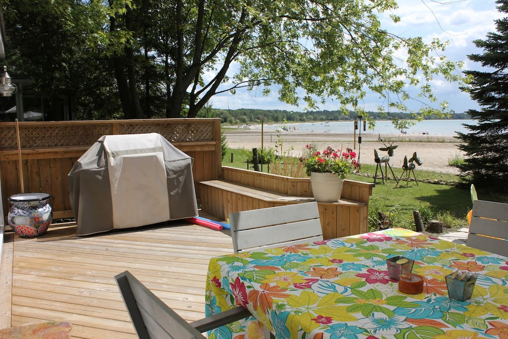 beach side deck with eating area and BBQ