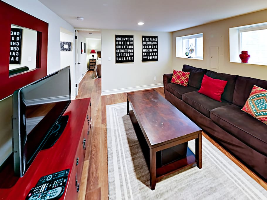The living area is adorned with modern furnishings and regionally inspired artwork.