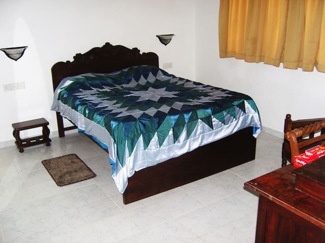 Double bed with spring core mattress